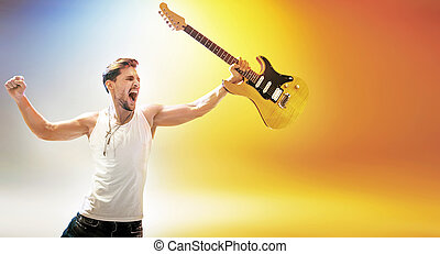 Portrait of the young rock star holding a guitar