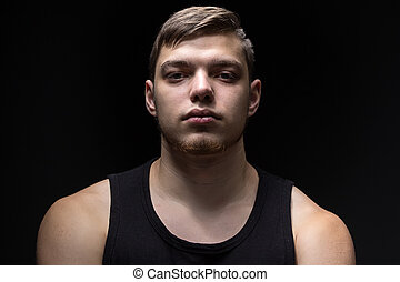 Portrait of the young strong man