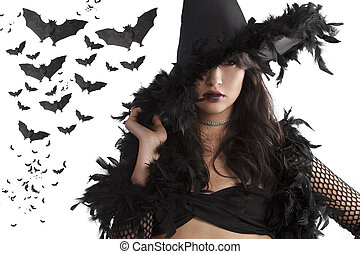 portrait of the young witch posing with black hat