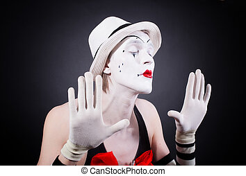 Portrait of theatrical mime on a black background