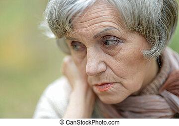 thinking elderly woman