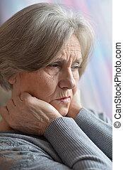 Portrait of thinking elderly woman
