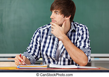 Portrait Of Thinking Male Teacher