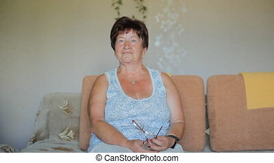 Portrait of thinking senior woman at home