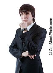 Portrait of thinking serious businessman