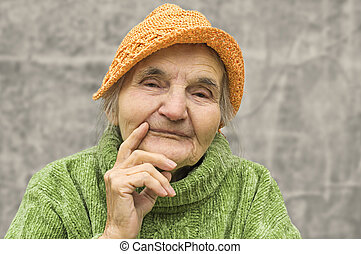 Portrait of thoughtful elderly woman