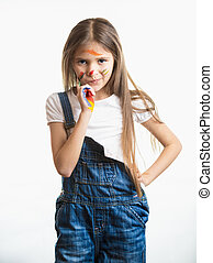 little girl with face in paint against white background