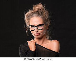 Portrait of thoughtful millennial blonde woman in eyewear looking suspiciously at camera, touching chin, doubtful, making important decision.