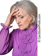 Portrait of thoughtful senior woman with headache on white background