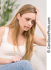 Portrait of thoughtful woman with bruise on her face. Looking away with sad look