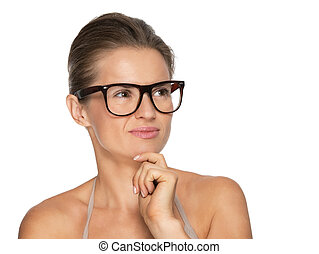 Portrait of thoughtful young woman in eyeglasses looking on copy space