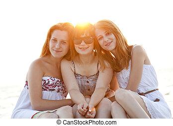 Portrait of three beautiful girls at the beach.