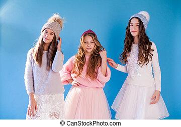 portrait of three beautiful girls in a winter hat
