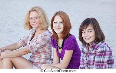 Portrait of three beautiful girls on the beach