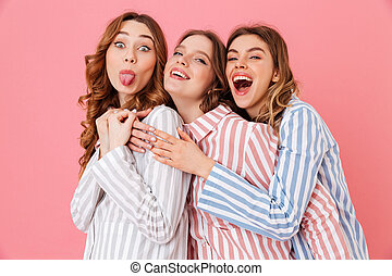 Portrait of three beautiful young girls 20s wearing colorful