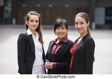 Portrait of three business women.