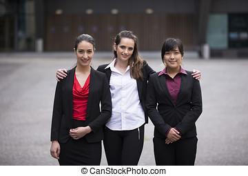Portrait of three business women.
