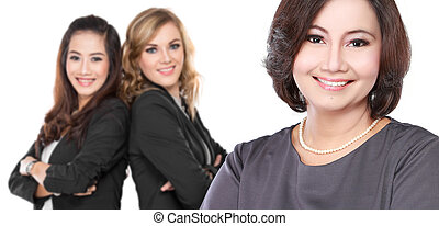 three businesswoman smiling to camera