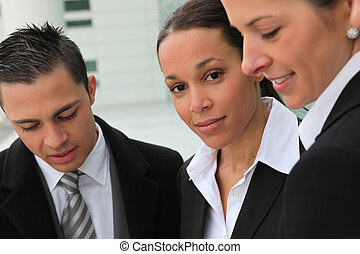 Portrait of three executives
