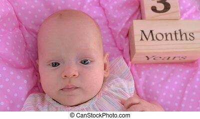 Portrait of three months baby girl - Close-up portrait of...