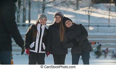 Portrait of three teenage girls wearing winter hats in...