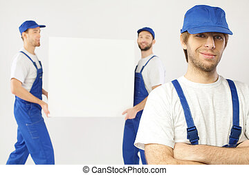 Portrait of three working builders