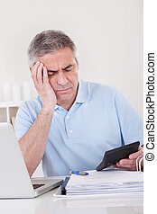 Mature Man Doing Finances