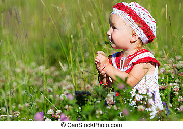 Portrait of toddler girl in meadow - Summer portrait of...