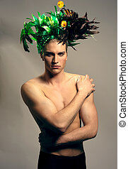 portrait of topless boy with interesting hair