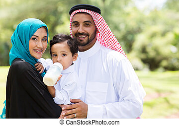 traditional muslim family - portrait of traditional muslim...