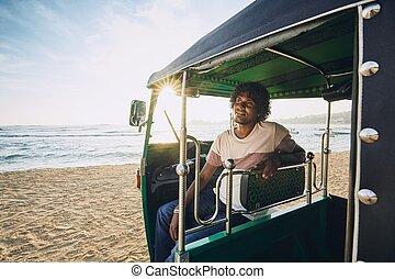 Portrait of tuk tuk driver - Young tuk tuk driver waiting...