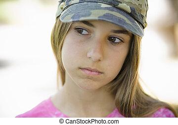 Portrait of Tween Girl in Cap Looking away from Camera