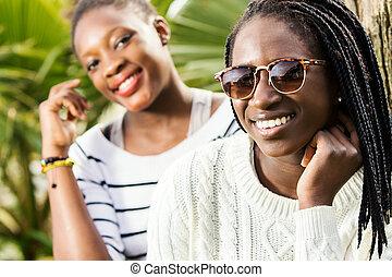 Portrait of two african teen girlfriends.
