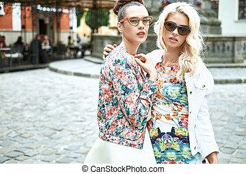 Portrait of two attractive girlfriends