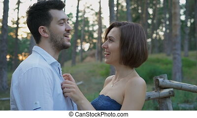 Portrait of two attractive young people, guys and girls in the pine forest.