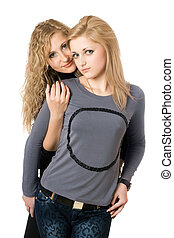 Portrait of two attractive young women. Isolated