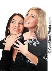 Portrait of two attractive young women embracing