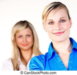 Portrait of two beautiful blonde businesswomen