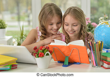 little girls doing homework - Portrait of two beautiful...