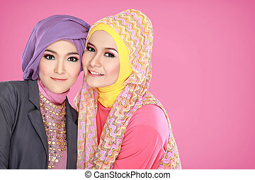 Portrait of two beautiful muslim woman together