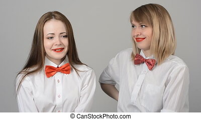 Portrait of two beautiful young women with butterflies on...