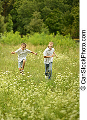 Portrait of two brothers running in nature