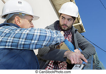 portrait of two builders outdoors