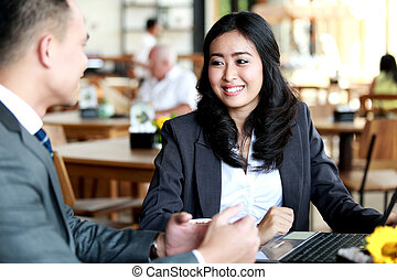 two business people meeting at coffee shop