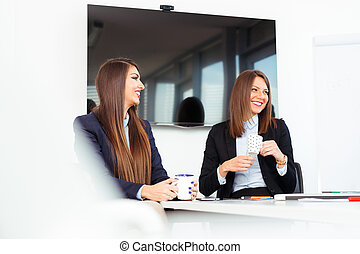 Portrait of two business woman working in office