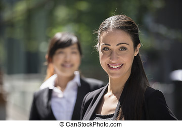 Portrait of two business women.