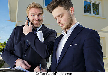 portrait of two businessmen outdoors