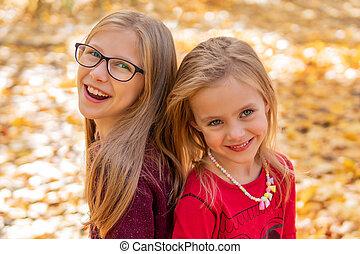 portrait of two children girls in autumn