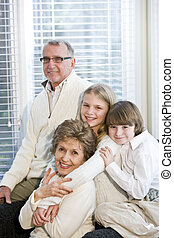 Portrait of two children with grandparents