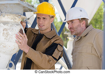 portrait of two construction workers outdoors